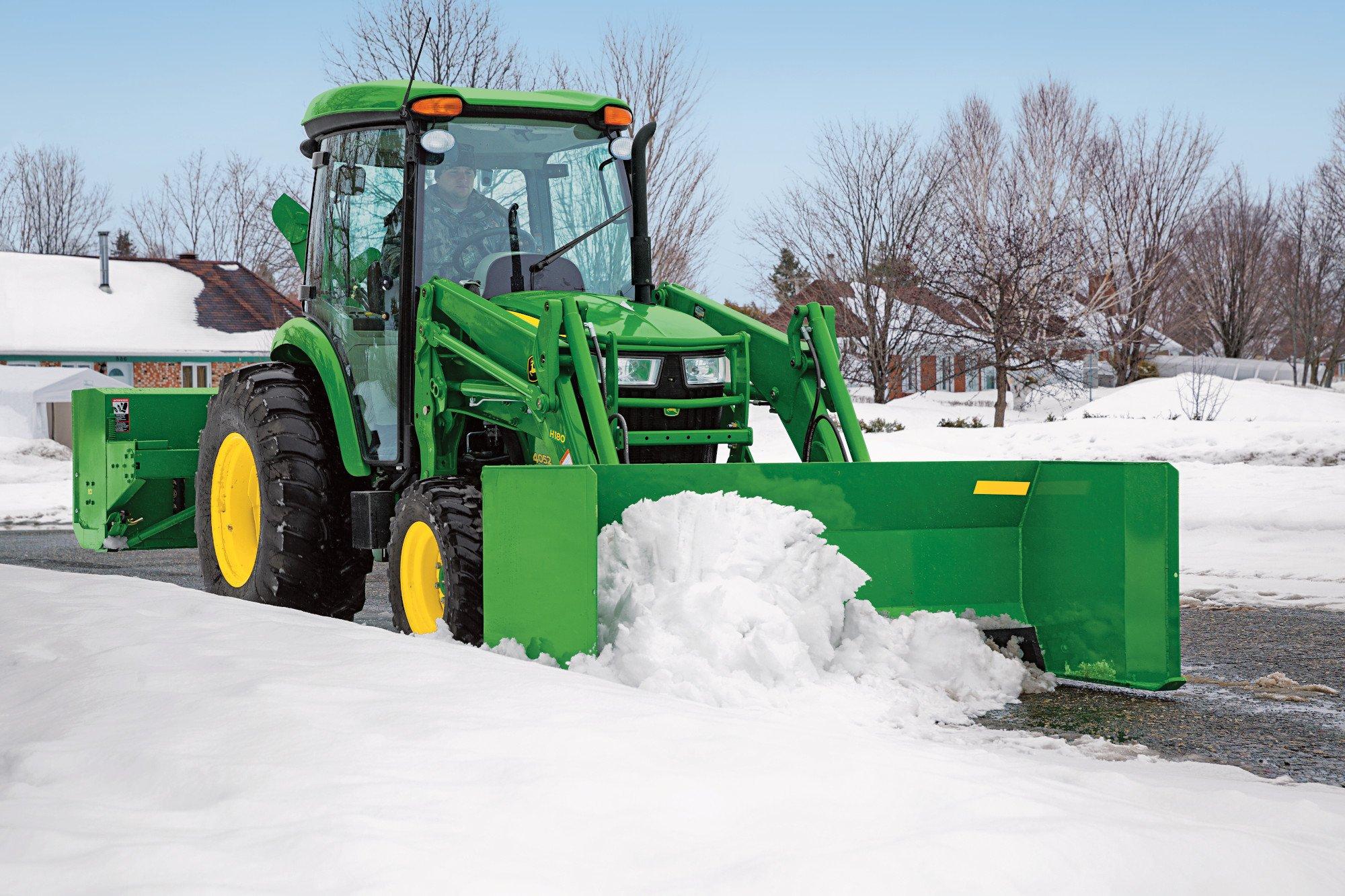 John Deere Compact Tractor with Frontier Snow pusher
