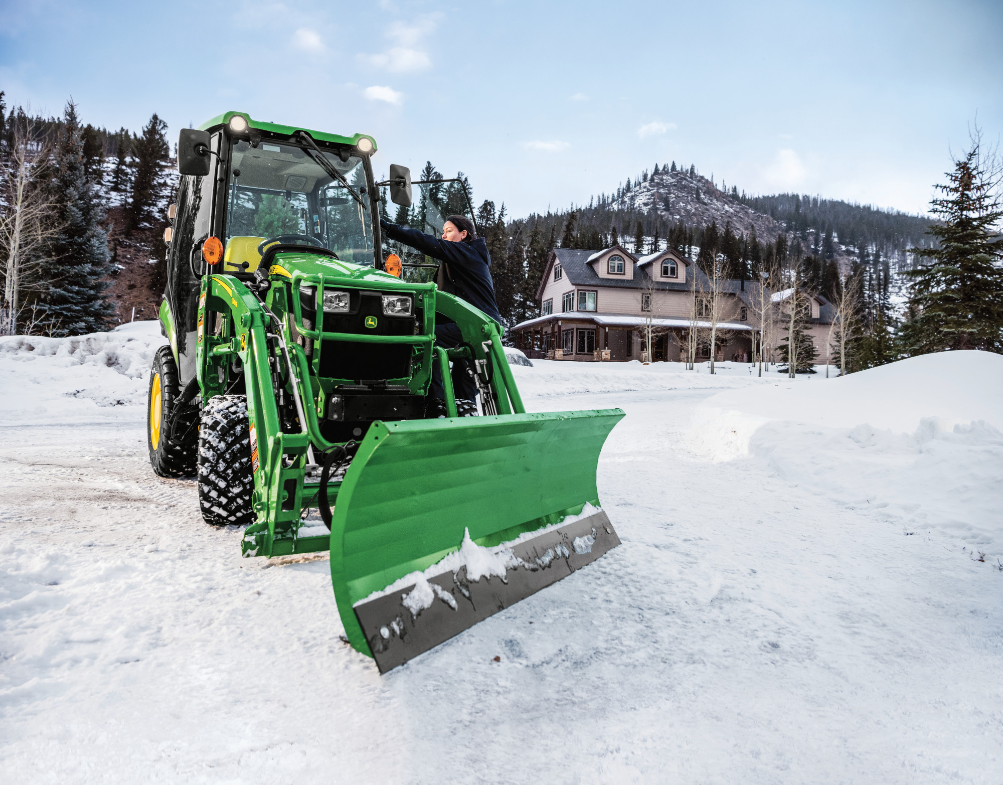 John Deere 1025R with cab and Frontier front blade