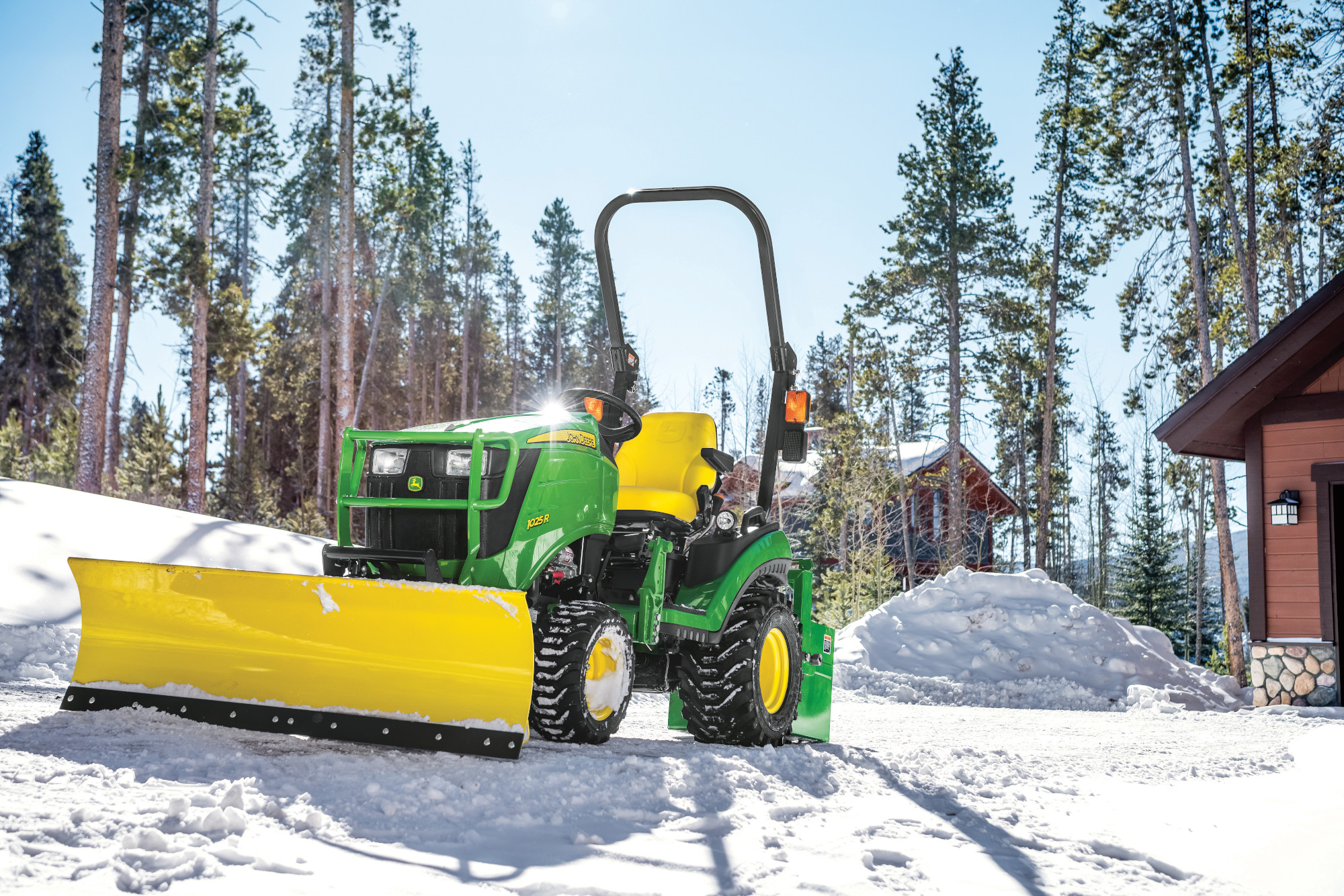 John Deere 1025R with quick hitch front blade