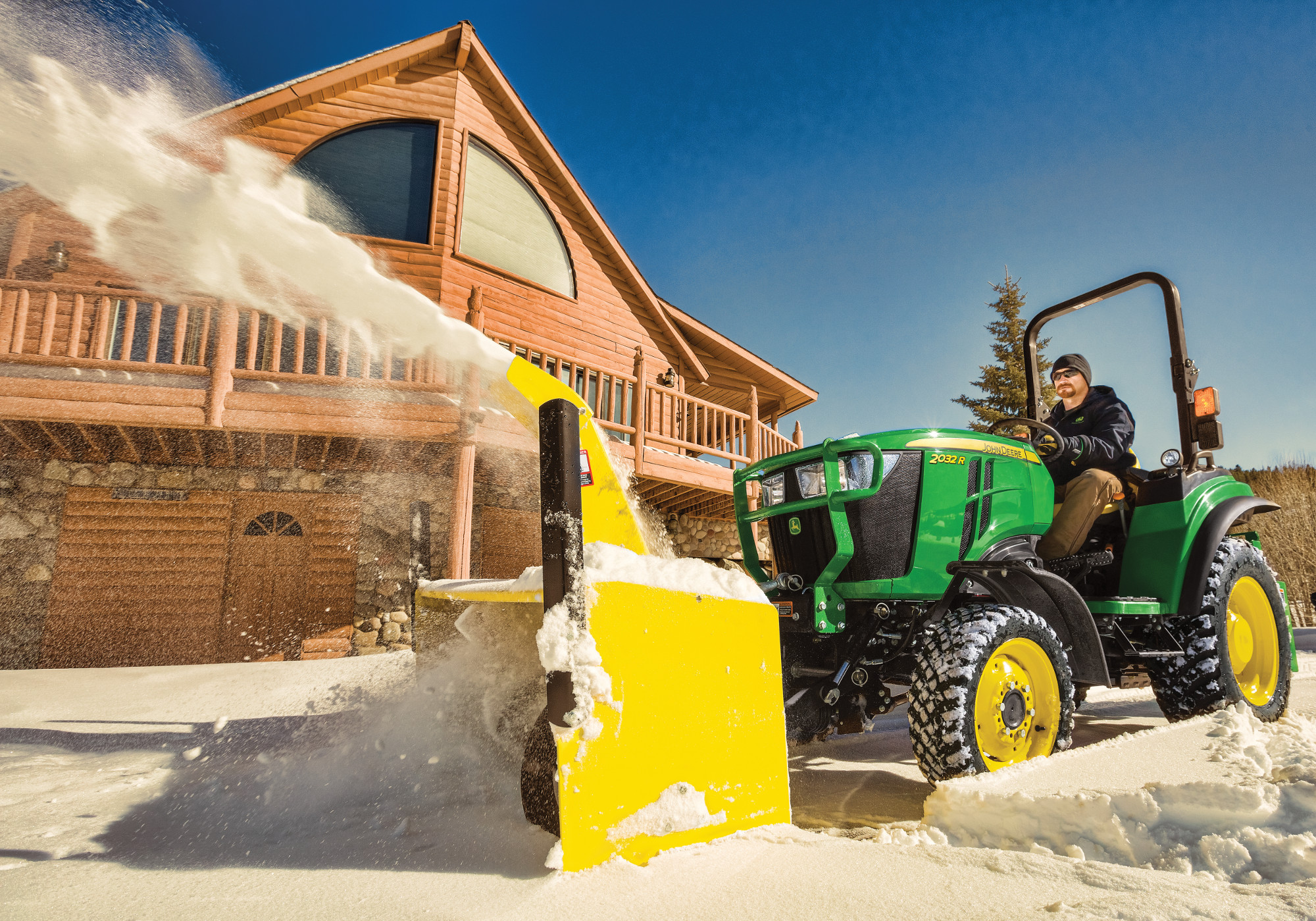 John Deere 2 Series with front mounted snow blower