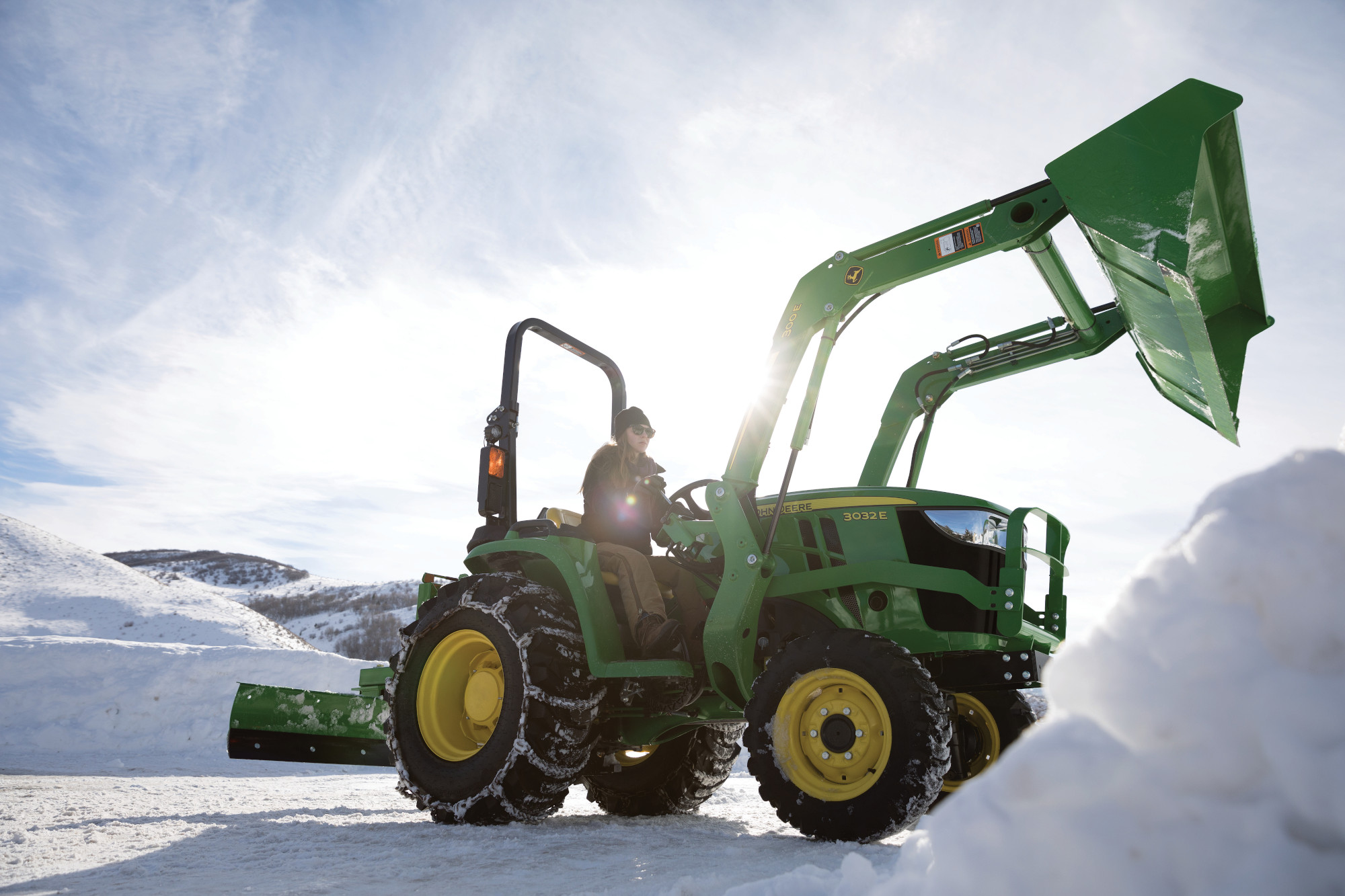 John Deere 3E Compact Tractor moving snow with loader
