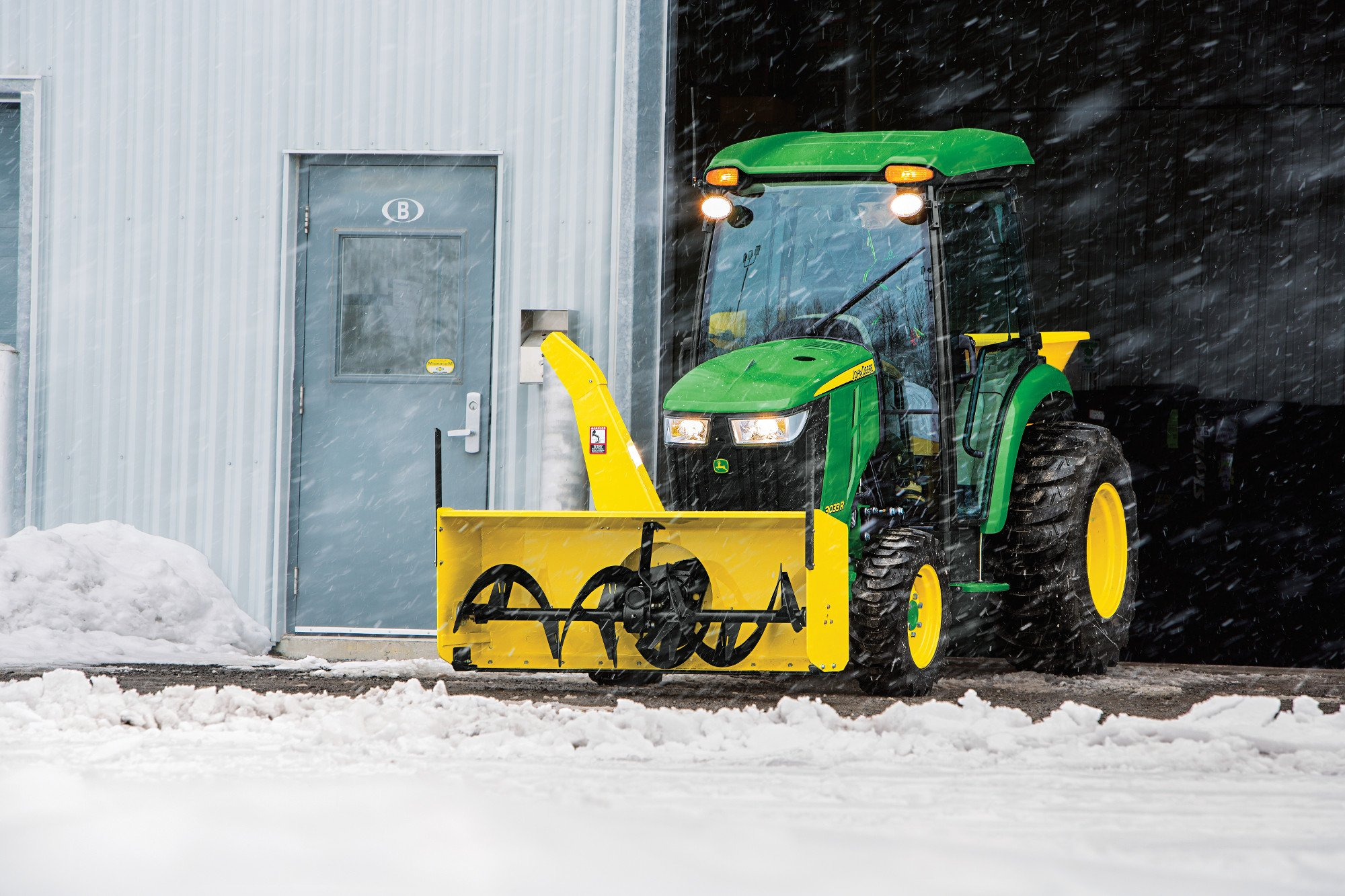 John Deere Compact Tractor with front mounted snow blower